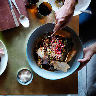 Slow-roasted Lamb Shoulder With Pistachios, Pomegranate And Vine Leaves.