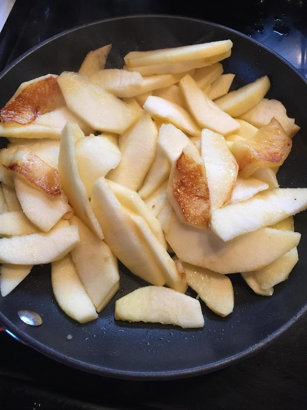 Add apples and fry in medium low heat covered, turning occasionally to brown but...