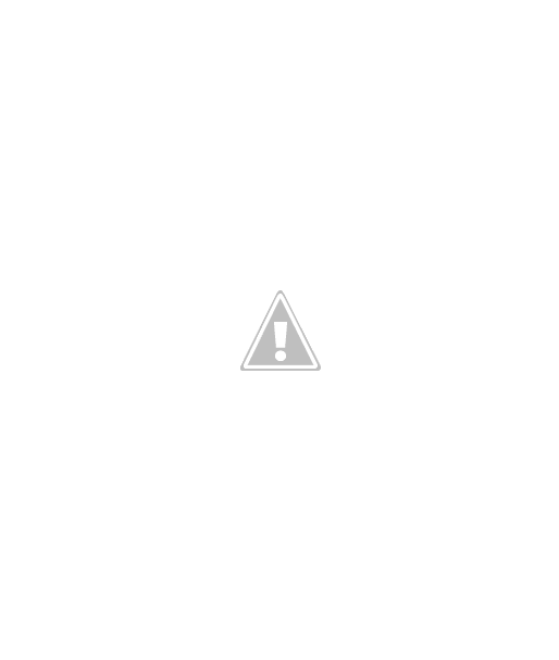 paper ornament of sequins on a red apple shaped paper, on a ribbon hanger.