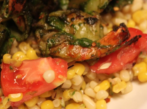 Plating starts with 2 serving spoons of Tomato basil corn slaw followed by 6...
