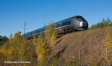Photo: BM71 Airport Express train (Flytoget), passing Lier outside Drammen, shortly after the service was extended to Drammen, South of Oslo