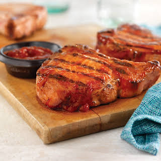 Grilled Ribeye (Rib) Pork Chops with Easy Spicy BBQ Sauce.