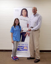 Photo: Mr G Of The United Way Presenting Kylee with $1000 for winning the Star Project! May 2013.