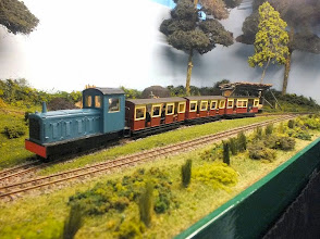 Photo: 019 The large diesel loco passes through with a new train of passenger stock, put into service when His Lordship decided to open the railway in the summer to tourist visitors – a welcome injection of revenue to the family coffers .