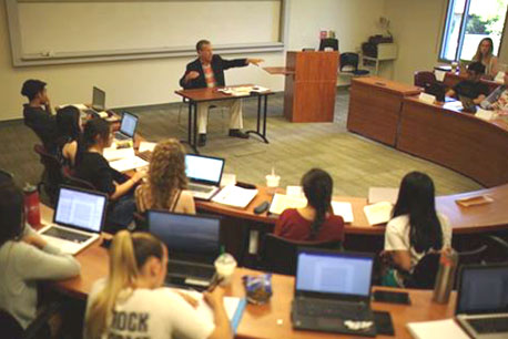 Professor lecturing to a small group of students