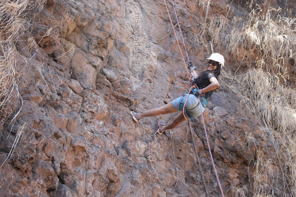 Thrill of rappelling while camping