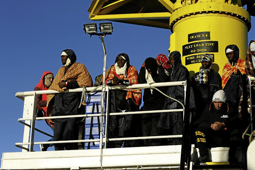 Hoping for a better life: Migrants wait for the MV Aquarius, a search-and-rescue ship run in partnership between SOS Mediterranee and Medecins Sans Frontieres, to enter Pozzallo on the island of Sicily, Italy, in November 2017. Picture: REUTERS