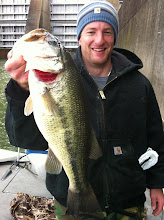 Photo: March 4, 2012 - Guide Sam Simons with a beast of a largemouth.