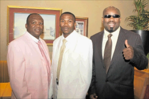 TOUGH TRIO: Paulos 'Hitman' Moses, WBA lightweight world champion from Namibia, flanked by former ring greats Dingaan Thobela, left,  and Nestor Tobias. Photo: Bafana Mahlangu