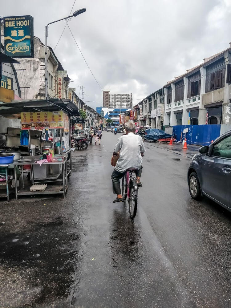 man+on+bicycle+penang+street+malaysia+asia