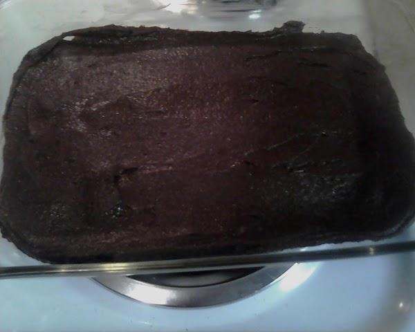 Spread into prepared baking pan.