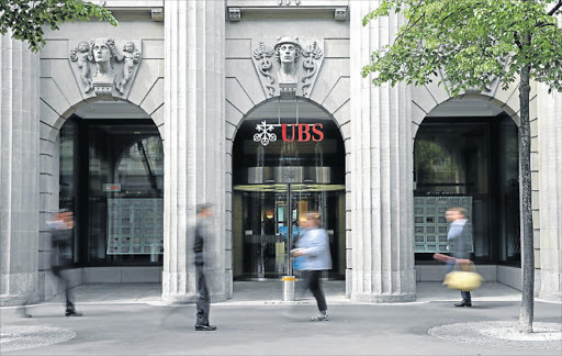 Pedestrians walk past the headquarters of UBS in Zurich. Picture: BLOOMBERG