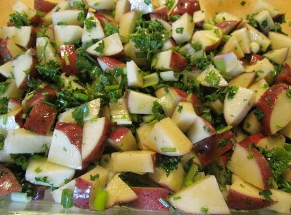 pour your olive oil over the potatoes, fold in your onions and parsley. I...