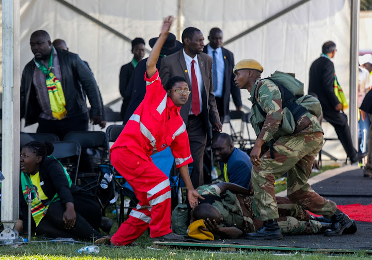 Medics attend to people injured in an explosion during a rally by Zimbabwean President Emmerson Mnangagwa in Bulawayo, Zimbabwe June 23, 2018.