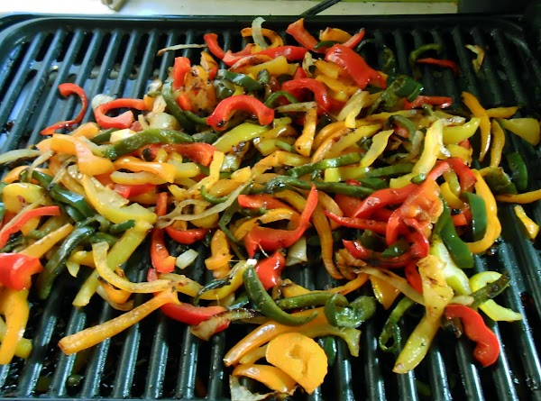 Slice peppers and onion, drizzle with olive oil and grill till tender.  Set...