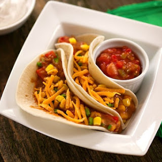 Vegan Soft Tacos with Refried Beans and Corn.