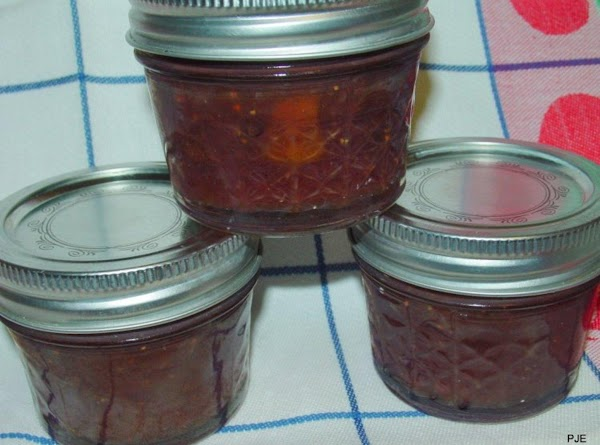 Pour into hot, sterilized jars, place two piece lids and process in a hot...