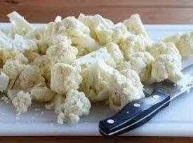 Wash and cut in half the cauliflower and cut out the hard bit in...