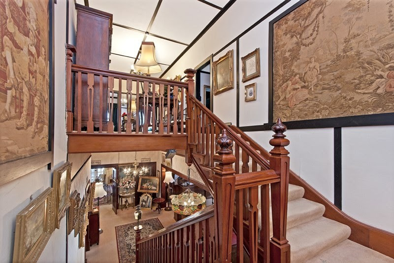 The mahogany staircase with a view of the lobby at 69 French Street, Hamilton