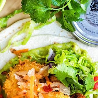 Prawn Tacos with Guacamole and Spicy Slaw.