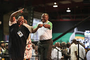 A victorious Cyril Ramaphosa is ushered onto the stage by an excited delegate after winning the ANC presidency at the party's 54th Elective Conference in Johannesburg on 18 December 2017.