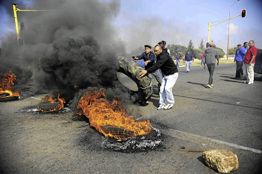 Fuelling the fire: Residents of Ennerdale, south of Johannesburg, during a protest on housing. Picture: THULANI MBELE