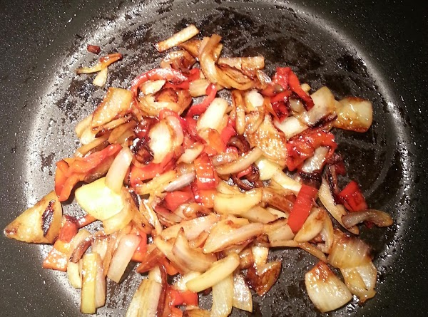 Add 2 tbsp olive oil into a frying pan. Add chopped onion, sweet peppers...