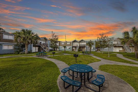Villas at Cedar Creek's apartment buildings and picnic area at dusk
