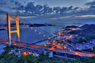 Photo: Seto-Ohashi Bridge & Shimotsui  The Seto-Ohashi Bridge is a massive bridge which links the main island of Honshu with the main island of Shikoku in Japan. The top level is used for cars and trucks, while the lower level is used for trains. Both means of crossing this bridge provide for beautiful scenery.  There are actually a series of these bridges which span the Inland Sea. This particular bridge exits Honshu at Shimotsui, though the neighboring (and much larger) city of Kojima is better known for the bridge.  Each Saturday night they turn on the lights on this bridge - so I had to take the opportunity to photograph it one evening!  This is actually my first serious attempt at a single photo HDR ... overall pretty pleased with the results. Hope you feel the same!  Thanks for viewing!