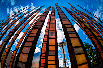Photo: Like Needles Poking the Sky  On my recent trip to Seattle I wanted to get over to the EMP building to get some shots as it is one of my favorite buildings ever. On the walk over I couldn't resist grabbing this fisheye shot of the Space Needle through one of the art sculptures nearby. The sun was high and the clouds were pretty so I snapped off a number of brackets to create this HDR image.  #seattle  #spaceneedle