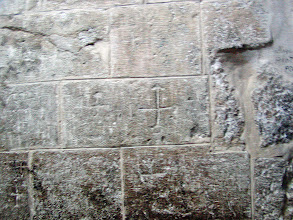 Photo: Pilgrims have etched crosses in the walls over the years.