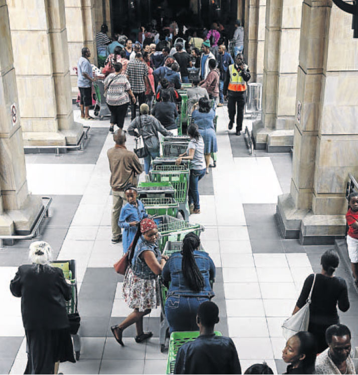 Shoppers queue at Checkers Hyper at the Pavilion Shopping Centre in Westville, Durban, on Black Friday last year.