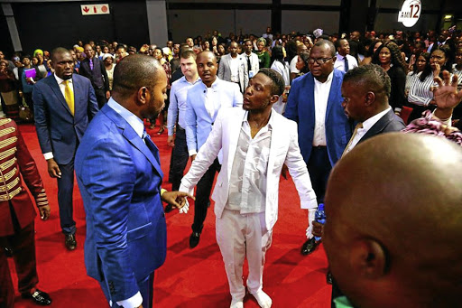 Pastor Lukau with the 'resurrected' man.