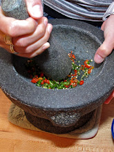 Photo: crushing the fresh Thai chillies just before they are needed