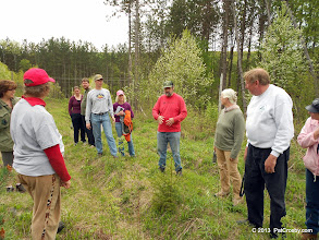 Photo: The forester in our midst had much to share about the trees, invasive species and ecology.