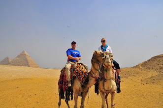 Photo: us on camels in front of the pyramids