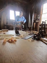Photo: Carpenter working on wooden toys at Carriage Hill Metropark in Dayton, Ohio.