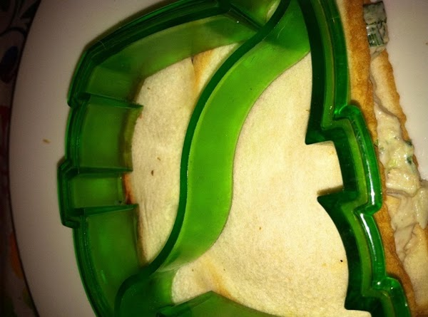 Place dinosaur cutter on top of the sandwich.  Press down firmly (wiggle gently...