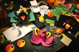 Photo: Halloween Pop Ups Half term here and Tabitha's been helping me prepare for my Pop Up Craft Intensive for Illustrators at the Society of Children's Book Writers and Illustrators Conference in Winchester this weekend. It's a stellar line up, with some top children's publishing stars, I'm looking forward to a really creative and stimulating weekend. I'm sure it will get every bit as messy as this! http://britishisles.scbwi.org/conference2014/programme/  #childrensbooks   #popupbooks