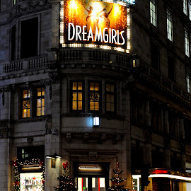 Melba and the Dreamgirls by DJ Cockburn - Buildings & Architecture Other Exteriors ( england, electric light, london, britain, night, christmas tree, restaurant, northbank, advertising, christmas, holiday, dreamgirls, building, savoy, the strand, westminster, hotel, luxury, façade, fine dining, poster, savoy theatre, architecture )