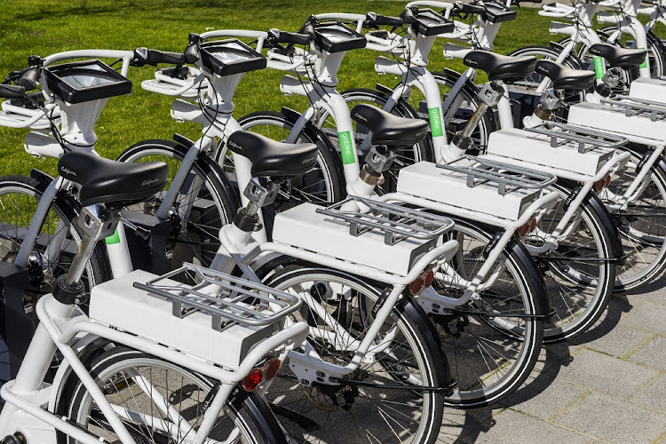 Rental e-bikes for tourists are parked on a bay in Rotterdam in the Netheralands. Picture: 123RF/Daniel Kloeg