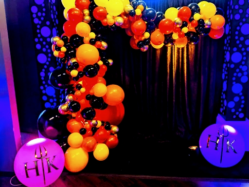 Custom balloon decor for your event!  Mix balloons, decor, props, printing and event lighting for a stunning effect.  By Dzign the the source for all your event needs.