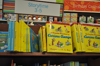 Photo: Maddie's choice for a great summer read lead us straight to the Curious George section.  There were lots to choose from.
