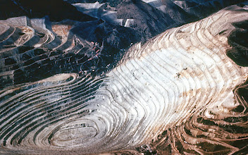 Photo: 57. A picture of the Kennicott [sic] open pit copper mine at Bingham, Utah. This is a mine of the same type which is proposed by this company to be placed on Miner's Ridge. This would require the building of an access road, transmission lines, mill site, town site, and tailing dumps, all in the very heart of the Glacier Peak Wilderness. As long as the mining laws operate, no wilderness place under Forest Service management is safe. Mining and prospecting are not permitted in national parks.