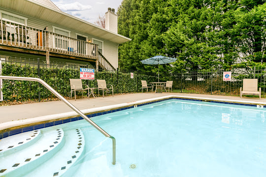 Swimming pool with view of apartment building