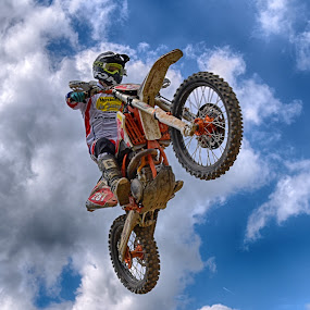 Hot Wheels ! by Marco Bertamé - Sports & Fitness Motorsports ( clouds, wheel, speed, 281, number, race, noise, jump, flying, sky, red, motocross, blue, cloudy, grey, air, high )