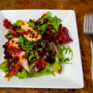 Apple-Pear Salad with Maple Pecan Bacon in a Cranberry Vinaigrette.
