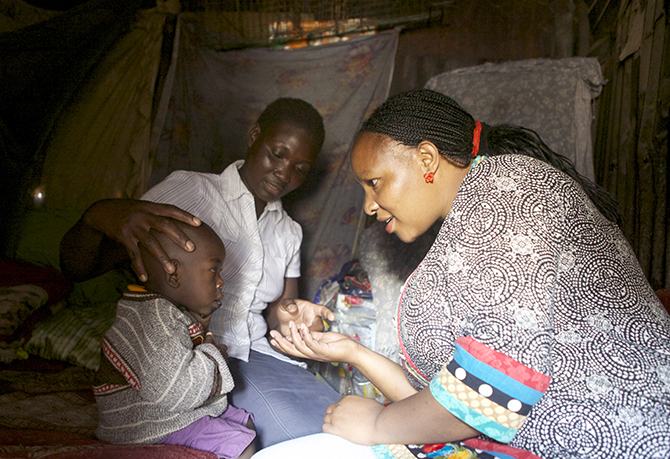 Tushinde lead social worker Beth visits a family in need