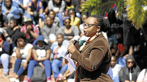 Sibongile Muthwa addresses students during a mass meeting at the Kraal on the university's south campus.      Picture: BRIAN WITBOOI