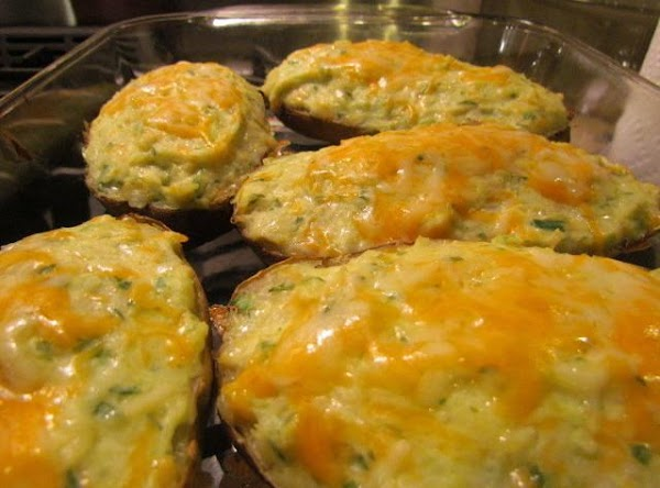 Bake at 350 degrees for about 30 minutes. take out and sprinkle with more cheese...